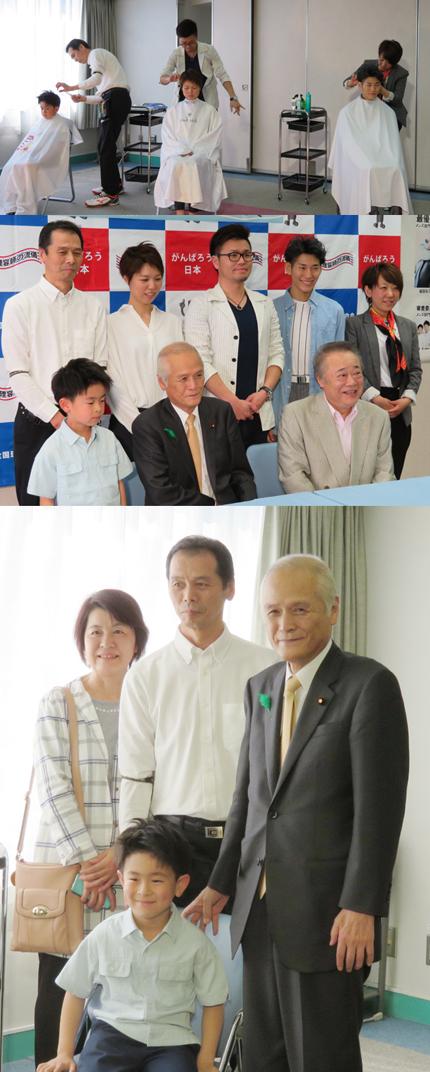 クールビズヘアの発表、モデルさんらとともに記念写真、地元理容師の船岡定さんと記念写真におさまる山本公一環境大臣(会場は、全理連ビル9階)
